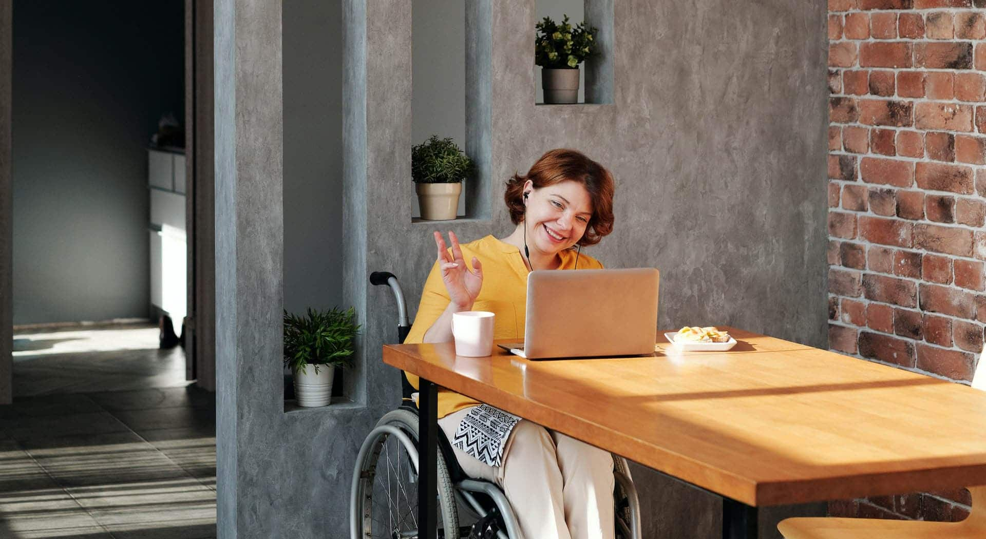 wheelchair user at table working